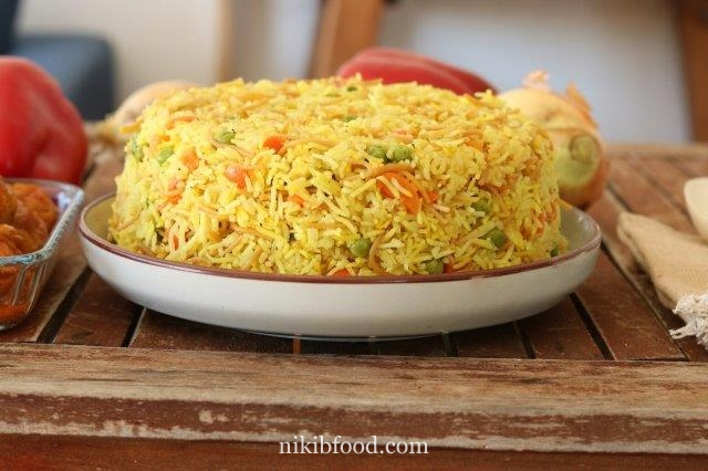 Yellow rice with carrots and peas